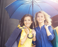 Two attractive young women with an umbrella Royalty Free Stock Photography