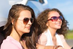 Two attractive young women wearing sunglasses Royalty Free Stock Photo
