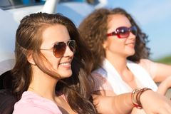 Two attractive young women wearing sunglasses Royalty Free Stock Image