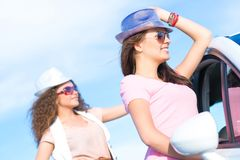 Two attractive young women wearing sunglasses Stock Photos
