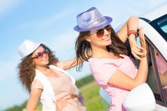 Two attractive young women wearing sunglasses Stock Images