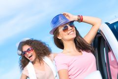 Two attractive young women wearing sunglasses Stock Photo