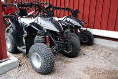 Two ATVs outdoor near the house Stock Image