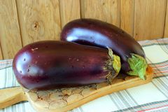 Two aubergine on a blackboard Stock Photo