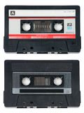 Two Audio Cassette Tapes on White. Two classic, retro audio cassette tapes on white background royalty free stock images