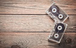 Two audio cassettes on a wooden table. Retro media technology from the 80s. Love of music. Copy space. Top view stock image