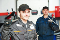Two auto mechanic repairmans Royalty Free Stock Photography
