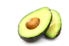Two avocado halves. Laying side by side Stock Images