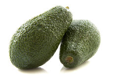 Two avocado's Stock Image