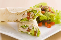 Two avocado wrap with a healthy side salad. Decorated Royalty Free Stock Photos