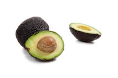 Two avocados on white Royalty Free Stock Photo