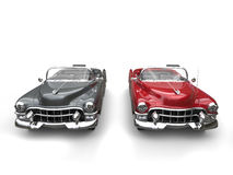 Two awesome black and red vintage cars. Isolated on white background Royalty Free Stock Images