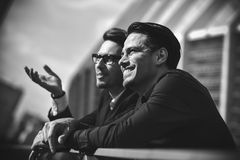 Two awesome business man have a rest between a work. stock photography