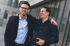 Two awesome business man have a rest between a work stock photography