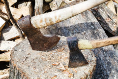 Two axes in block for chopping firewood Royalty Free Stock Images