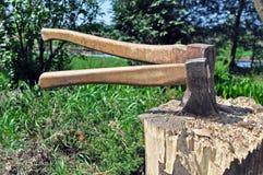 Two axes in a chopping block Stock Photos