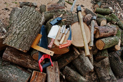 Two axes in stumps with wood working tools background  Stock Photography