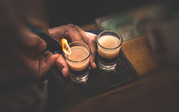 Two B 53 cocktails. With lighter royalty free stock photo