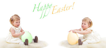 Two babies with Easter eggs Royalty Free Stock Photos