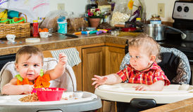 Two Babies Eat Breakfast Royalty Free Stock Image