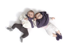 Two babies lying together Stock Image