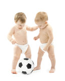 Two babies playing soccer ball over white Royalty Free Stock Photos