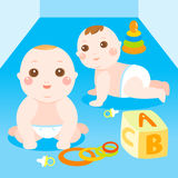 Two babies playing toys Royalty Free Stock Images