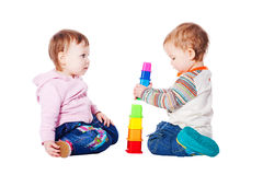Two Babies Playing With Toy Stock Image
