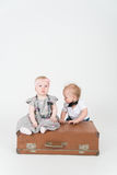 Two babies with the suitcase royalty free stock images