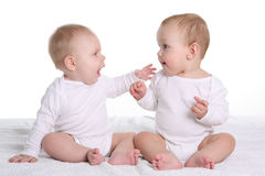 Two babies talking Royalty Free Stock Image