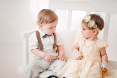 Two babies wedding - boy and girl dressed as bride and groom Royalty Free Stock Photography