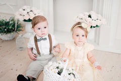Two babies wedding - boy and girl dressed as bride and groom Stock Image