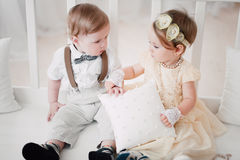 Two babies wedding - boy and girl dressed as bride and groom Royalty Free Stock Images