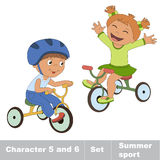 Two baby boy and girl ride a bike Stock Photos