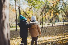 Two baby boy playing in autumn Park,run and jump Royalty Free Stock Images