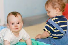Two baby boys indoors. Portrait of two baby boys indoors Stock Photos