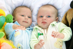 Two baby boys twins stock photos