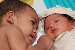 Two baby brothers lying together Stock Images