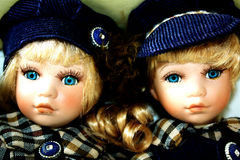 Two baby dolls. Two dolls, baby boy and baby girl stock photos