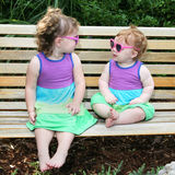 Two baby girls in sunglasses and sun dresses-2 Stock Photography
