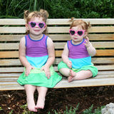 Two baby girls in sunglasses and sun dresses-3 Royalty Free Stock Photography