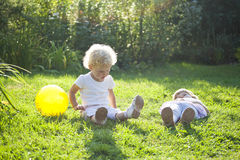 Two baby on a grass royalty free stock photography