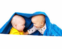 Two baby playing Stock Photography