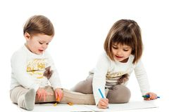 Two baby sisters drawing together. Royalty Free Stock Photography