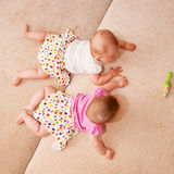 Two baby twins crawling togethe Stock Photo