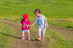 Two baby walking in a field Royalty Free Stock Images