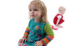 Two babyes sitting on the floor. Two girls and toy are sitting on the floor Stock Photos