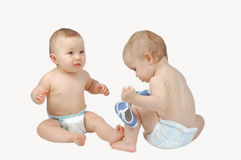 Two babys playing Stock Images