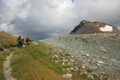 Two Backpackers Approaching Fissile Peak Stock Photography