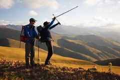 Two backpackers in the mountain Royalty Free Stock Photography